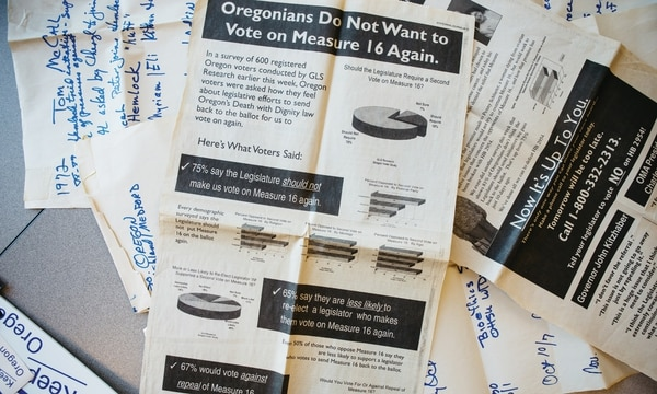 Campaign materials from Measures 16 and 51, both of which asked Oregonians to decide on doctor-assisted suicide. (Christine Dong)