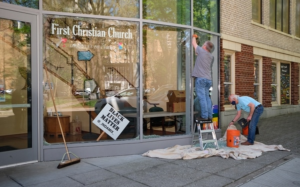 SHATTERED: Rioters shattered windows at the First Christian Church downtown.