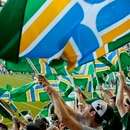 Timbers Army waving flags. (Lander Beauchamp)