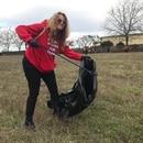 Volunteer and Oregon for Trump member Melissa Petersen picks up trash at the Salem, Ore. event.