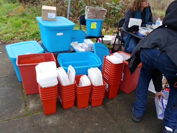 Sharps containers at a needle outreach event. (Courtesy of Leslie Corless)