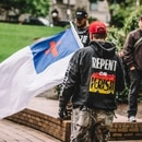 """This white flag, which flew May 13 in downtown Portland, is a symbol of the Christian Identity movement, a white supremacist theology that has been associated with the Ku Klux Klan as well as right-wing """"patriot"""" militia groups. (Sam Gehrke)"""