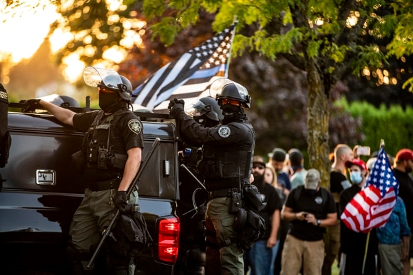 SOCIAL DISTANCING: Riot police are regularly called upon to keep dueling demonstrators from injuring each other. (Sam Gehrke)