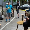 Patrons along the sidewalk and seating area outside The Beer Store, in Milwaukie. (Alex Wittwer)