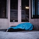 A homeless man sleeps in a Portland doorway in January 2017. (Joe Riedl)