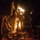 Portland protesters set fire to a statue of a pioneer family called