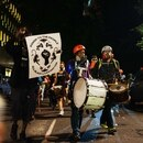 Drummers march down SW Salmon Street towards 4th Avenue on July 25. IMAGE: Alex Wittwer.