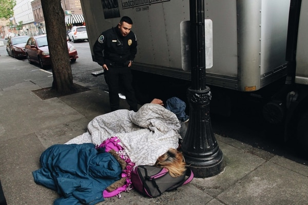 Private security officers roust people sleeping on downtown streets at 7 am. (Laurel Kadas)