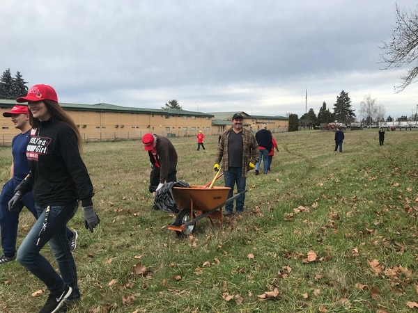 A group of volunteers clean-up the grassy field on Saturday, Jan. 25.