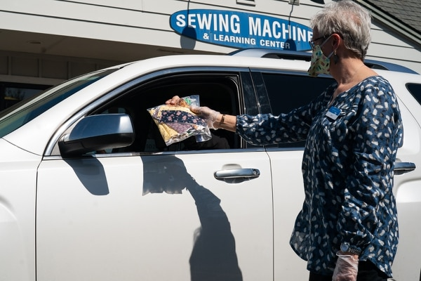 Carrie Garvey, manager of Montavilla Sewing Company's Gresham store, distribute fabric masks to Portland-area hospital workers.(Christine Dong)