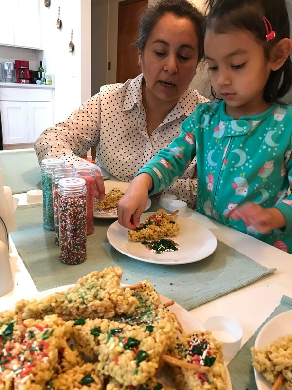 Valderrama's mom, Ana, and daughterdecorate holiday treats together this pastDecember (below). Ana cooks traditionalPeruvian food and helps Valderrama with herdaughter when she can.