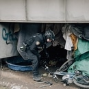 A Portland police officer looks for stolen bikes. (Henry Cromett)