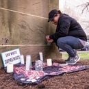 Larnell Bruce Jr.'s mother, Christina Miles, leaves a candle at a memorial following the guilty verdict in her son's murder. (Wesley Lapointe)