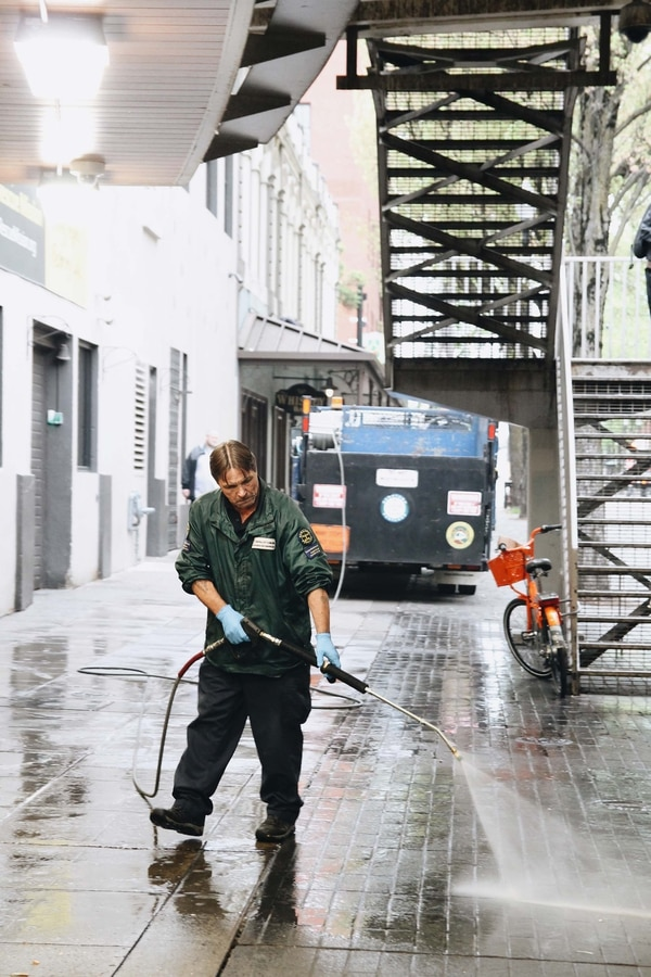 An early morning cleanup near the Burnside Bridge removes the smells and bedding from the night before.(Laurel Kadas)