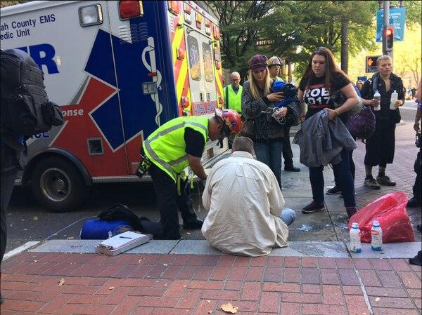 Activist Jessie Sponberg receives treatment after being pepper-sprayed on Oct. 12, 2016. (KATU-TV)
