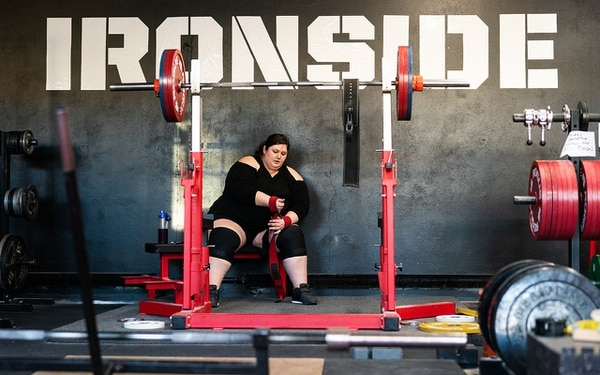 STAY STRONG: Malone prepares before a 440-pound lift at Ironside Gym in Southeast Portland. Before each lift, she visualizes each movement in detail. (Christine Dong)
