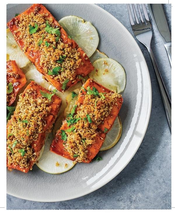 The Walnut Crusted Salmon, served with daikon radishes and cilantro garnish. (Amazon)