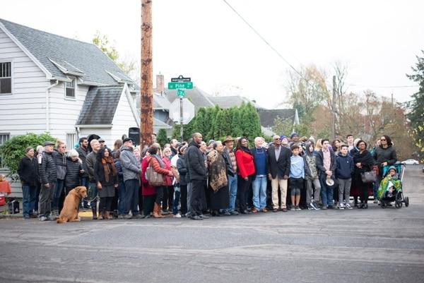 Citizens pose for a photo at a memorial for Mulugeta Seraw. (Anna Del Savio)