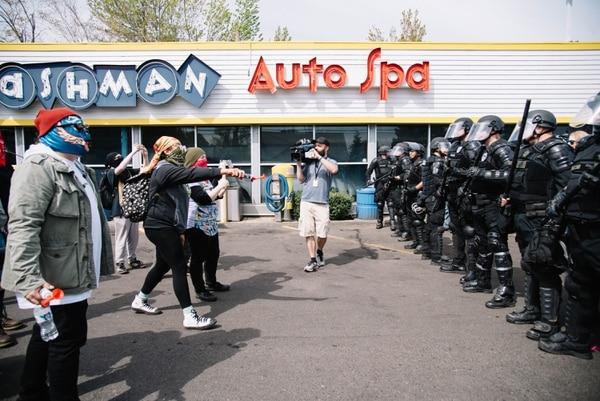 "Antifa protesters confront Portland riot police at an April 29 ""free speech"" march. (Joe Riedl)"