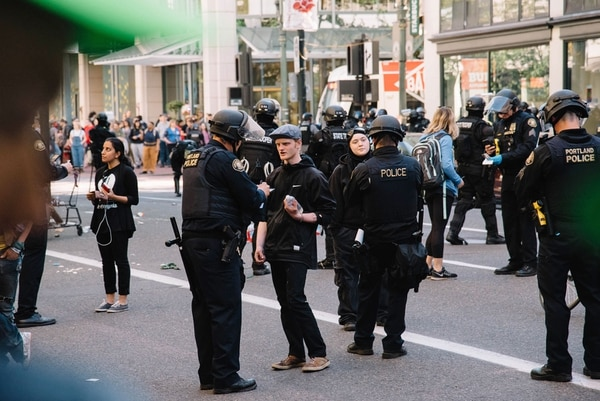 """Portland police check IDs at a police """"kettle"""" on June 4. (Joe Riedl)"""