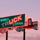 The iconic Baker Truck Corral sign is one of several vintage roadside neon signs throughout Baker County, Oregon. (Baker County Tourism)