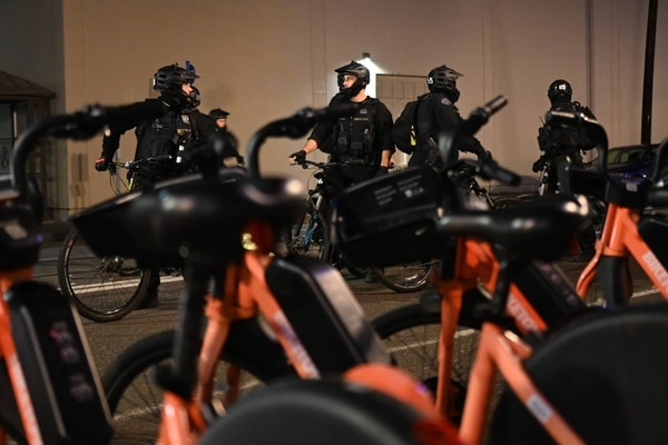 Portland police officers and Homeland Security agents coordinate a response to protesters on the South Waterfront. (Justin Yau)