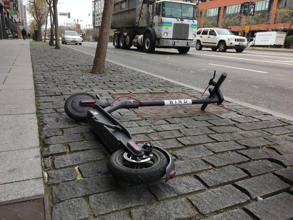 A rental scooter left on the San Francisco sidewalk. (Dan Brekke / KQED)