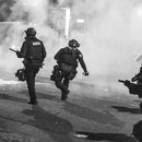 Portland police officers deploy munitions along North Lombard Street on June 30, 2020. (Dylan Van Weelden)