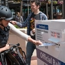 A voter casts a ballot in Pioneer Courthouse Square on Tuesday, May 17. (Joe Glode)
