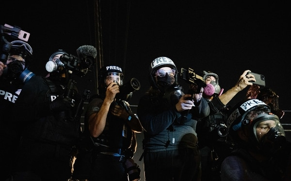 A gaggle of journalists awaits a confrontation between police and protesters on Southeast Stark Street on Sept. 5.(Alex Wittwer)