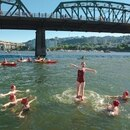The synchronized swimming troupe called the Rose City Raindrops perform in the Willamette River in the summer of 2018. (Thomas Teal)