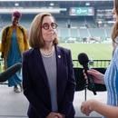 Oregon Gov. Kate Brown at a ceremony to announce the reopening of Oregon. (Wesley Lapointe)