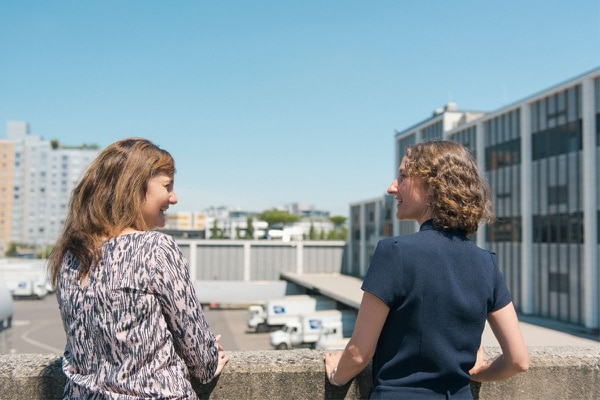 Prosper Portland's Lisa Abuaf and Kimberly Branam look out over the future Broadway Corridor development site at the central U.S. Post Office. (Thomas Teal)