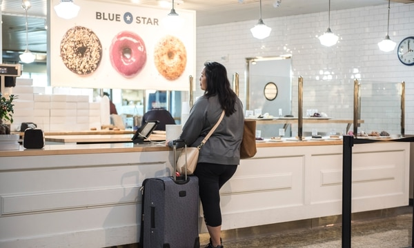 Portland-based Blue Star Donuts began doing business at PDX in 2016, along with local operations Tamale Boy and Tender Loving Empire. (Thomas Teal)