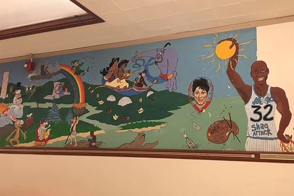 Murals at Glencoe Elementary portray Huckleberry Finn and Jim, Vera Katz and Shaquille O'Neal. (courtesy of Kelley Sigler)