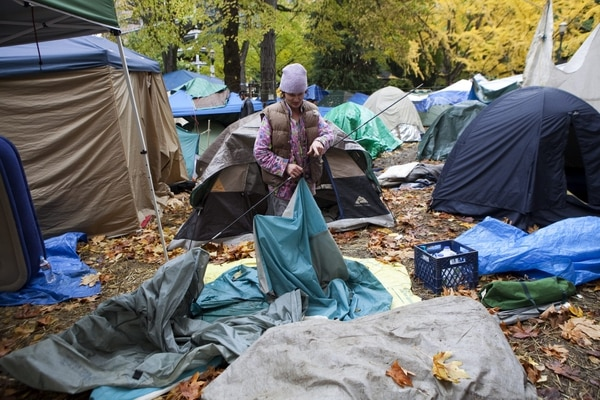 Stacy Satter packs up her tent to leave the Occupy Portland camp November 12, 2011. (Vivian Johnson)