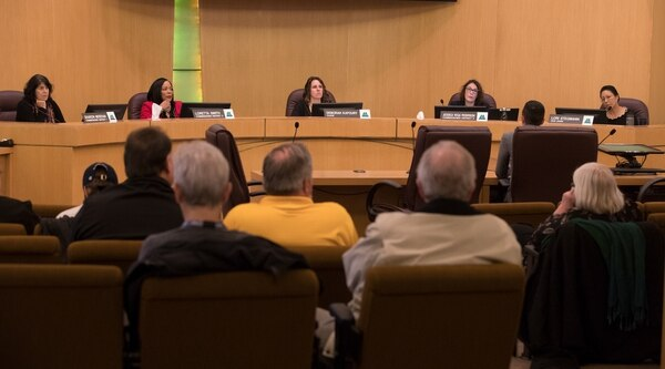 Gold-shirted UFCW members regularly showed up at county board meetings to support Greg Anderson and the CIC. (Motoya Nakamura / Multnomah County)