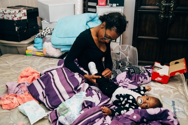 CHANGEOVER: Finney's daughter Dazjonae Finney, 21, and granddaughter Laniyah Barrow, 7 months, before the family learned they had a reprieve. (Henry Cromett)
