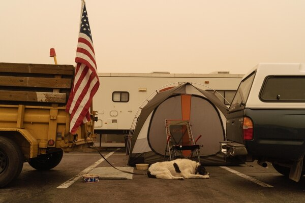 Teena Putvain's 17-year-old companion sits in the parking lot of a strip mall in Oregon City, off S. Beavercreek Road.