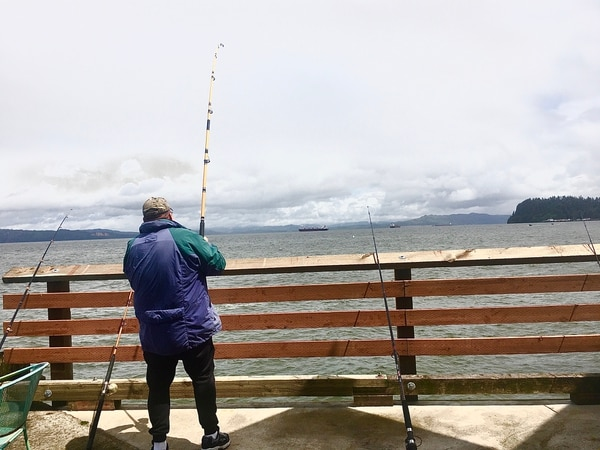 An angler is hoping to catch another large sturgeon from Pier 39 near Coffee Girl. Photo by Andi Prewitt.