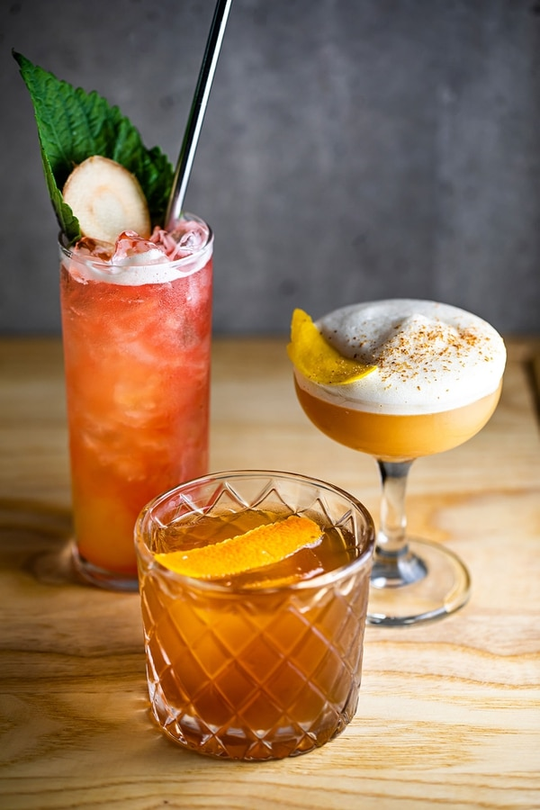 Suckerpunch's early drink menu includes (clockwise from left) the Island Boy, Thank You for Being a Friend, and Straight From the Fire. IMAGE: Carly Diaz.